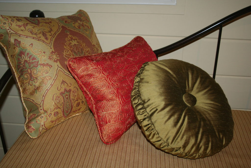 Pillow grouping, valances, shutters and bedding