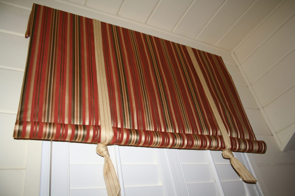 Valance installed and new shutters, bedding, pillows and more to see in this daybed makeover