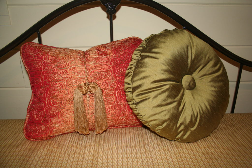 Added a tassel tie to the orange pillow, valances, shutters, bedding