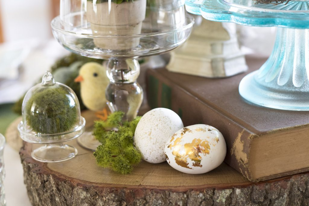 Wood slices, eggs, wool chick and moss, Easter Table