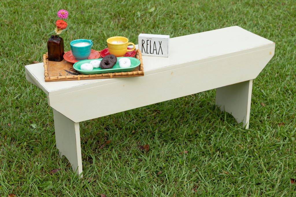 Relax for an afternoon coffee and sweet treat on this rustic bench