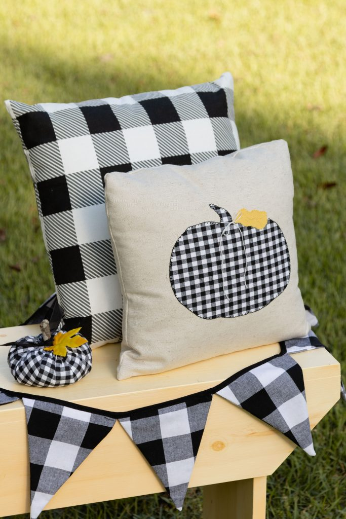 Pumpkin pillow sitting on our one-board-bench and our handmade pumpkin, get all the free patterns and how-to