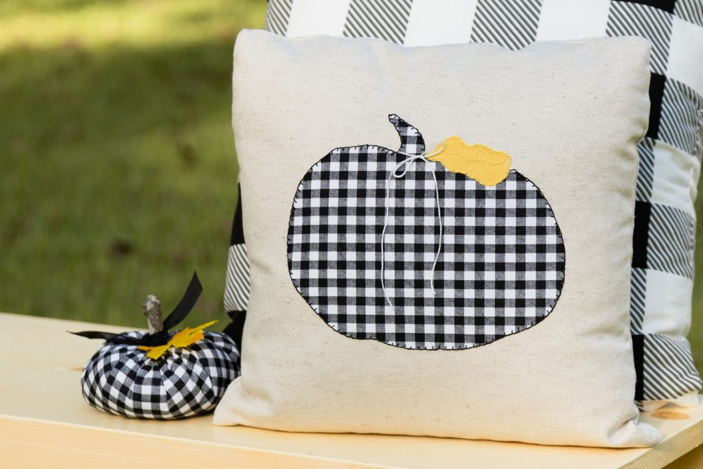 Black and white plaid/check pillows and pumpkin ready for fall, easy applique pattern
