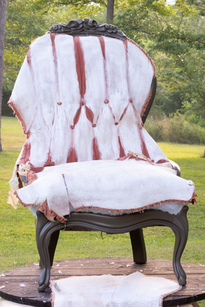 The original fabric placed over the painted chair