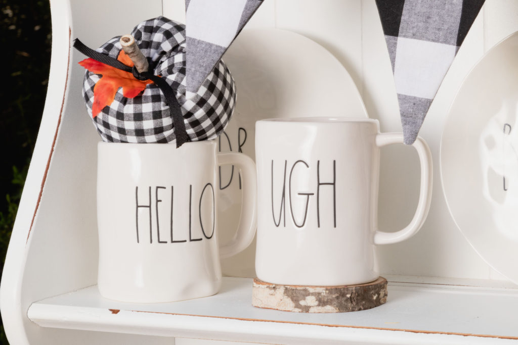 Rae Dunn mugs with wood slice and black and white checked pumpkin