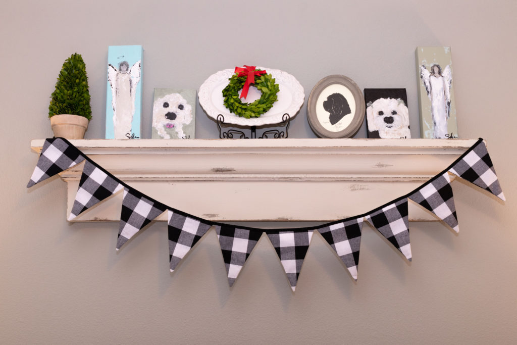 Bedroom display shelf with boxwood wreath and buffalo check bunting