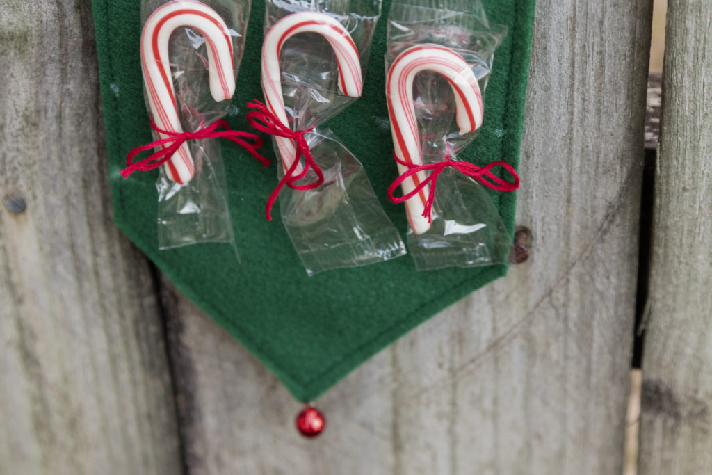 Point of the candy ribbon with jingle bell