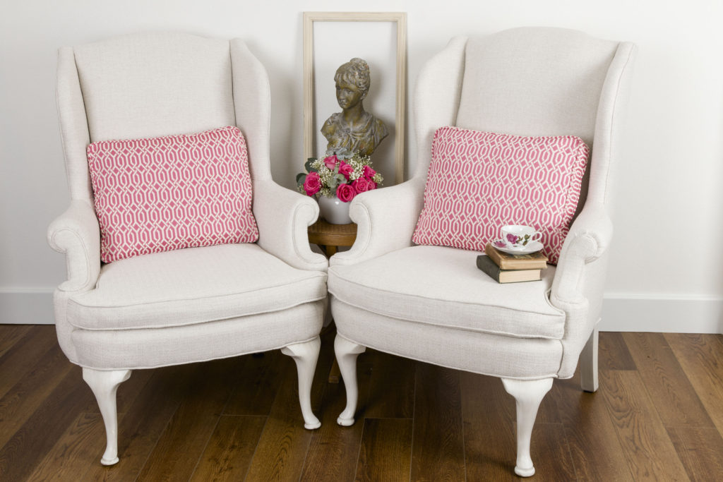 Wingback Chairs with Pink Geometric Pillows