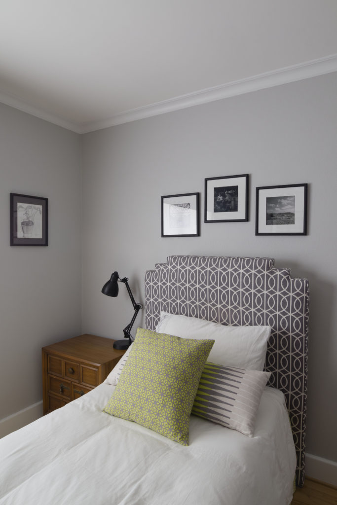 Perfect pattern match on the head board and cornice board, Modern boys room DIY makeover has custom designed details