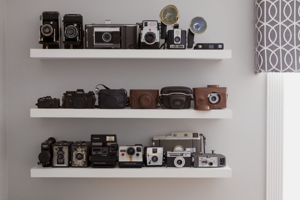 Vintage camera collection, this modern boys room DIY makeover has some unique statement pieces