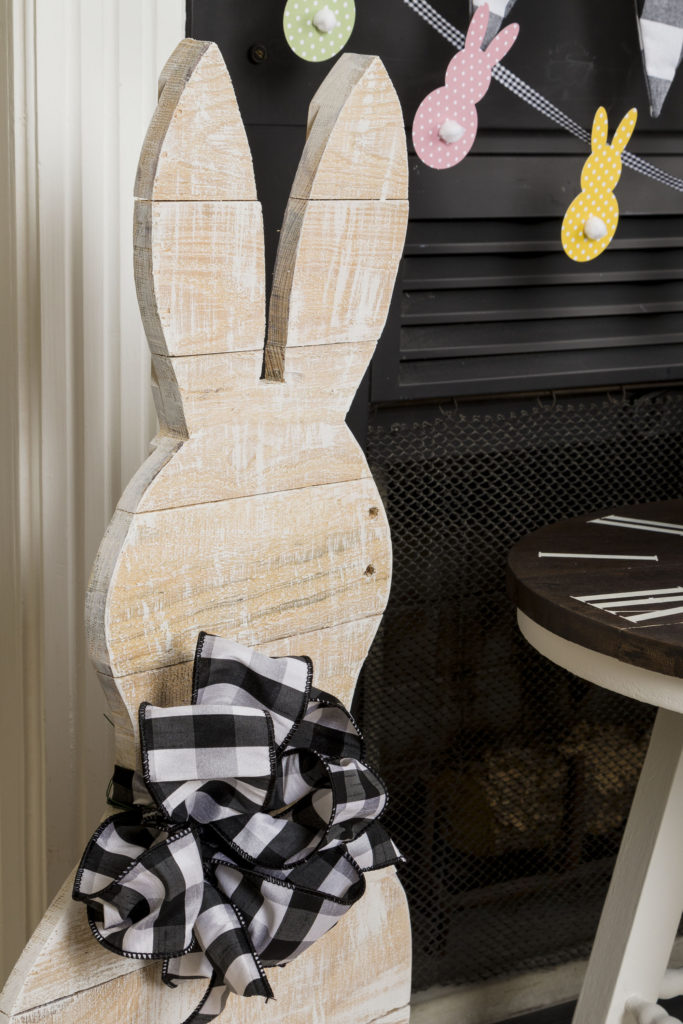 Standing Mr. Bunny with buffalo check bow, bunny banner, bunny pillow, flower pots