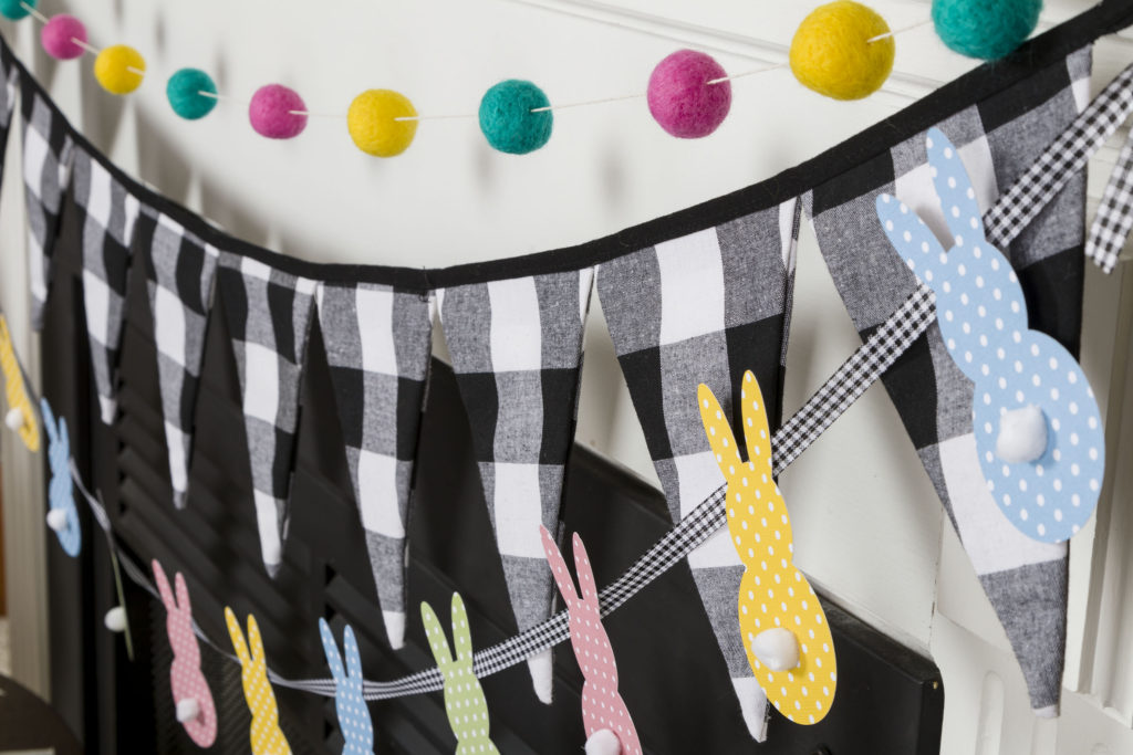 Banners, pompoms, buffalo check, bunnies, fireplace ready for spring
