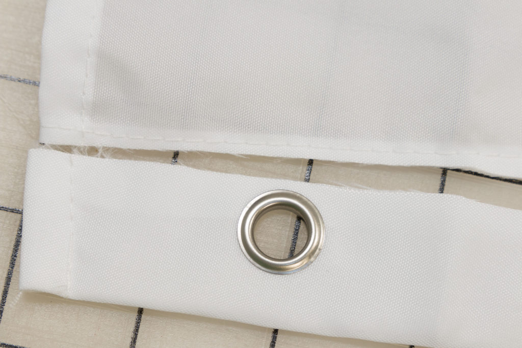 Removing the grommets, before adding ties to shower curtain