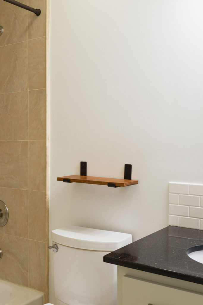 Exotic wood shelf attached with strap brackets