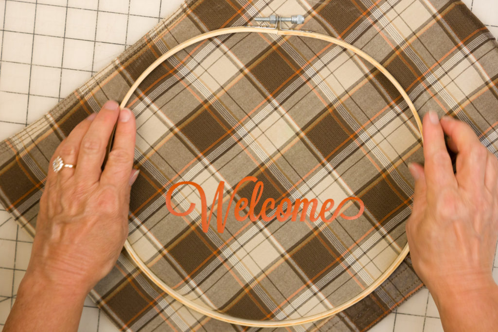 Placing the fabric in the embroidery hoop