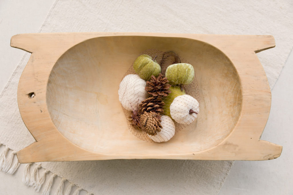 Dough bowl with velvet and pine cone fillers