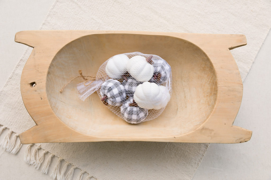 Vintage dough bowl with white and gray buffalo check pumpkins vase filler.