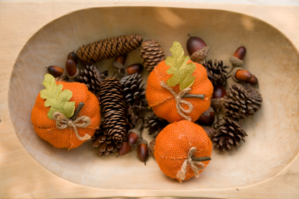 Dough bow with burlap pumpkins, pine cones and acorns.