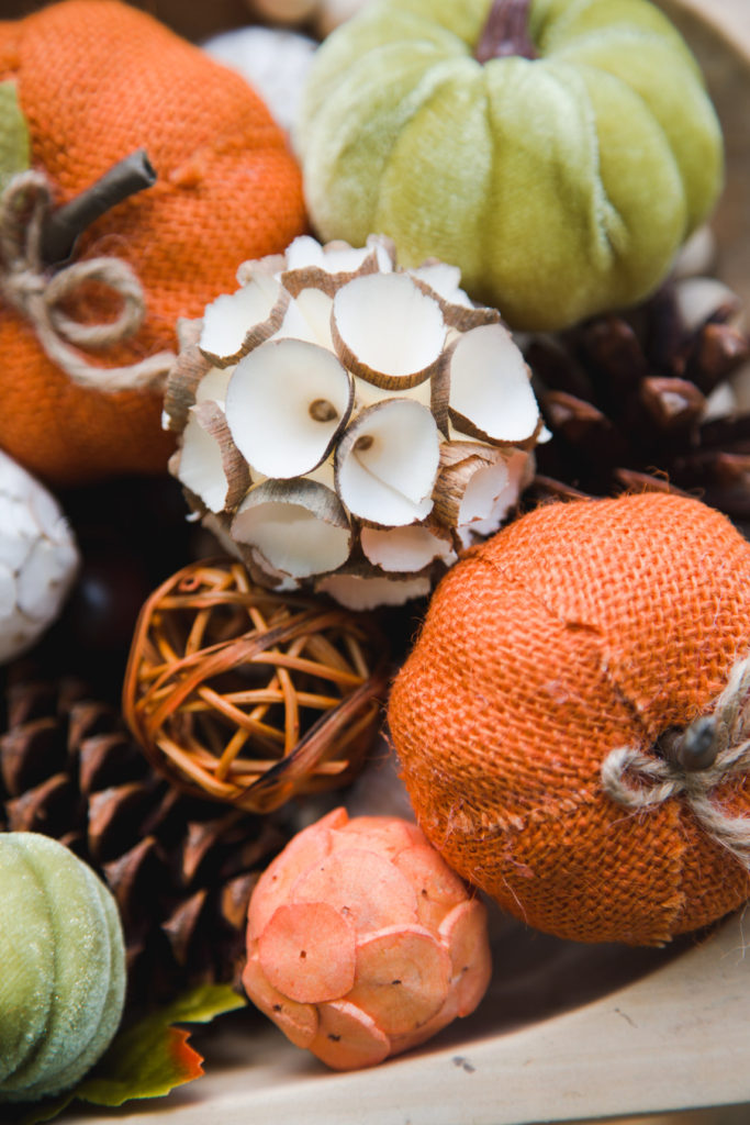 Texture and variety add visual interest to your fall table arrangements (pine cones. pumpkins, and twig balls, etcl