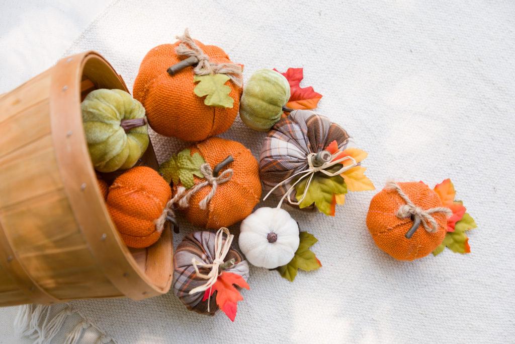 Extra vase filler pumpkins and more spilling out of a basket