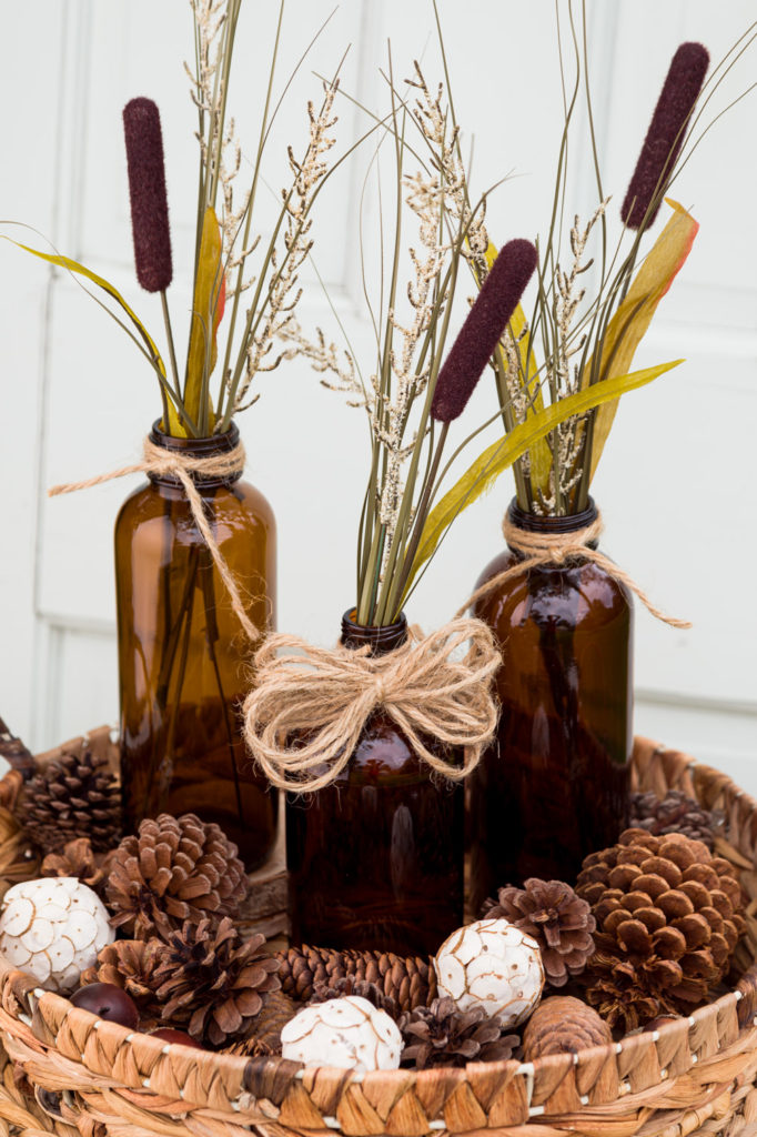 Wicker tray with bottles and cattails