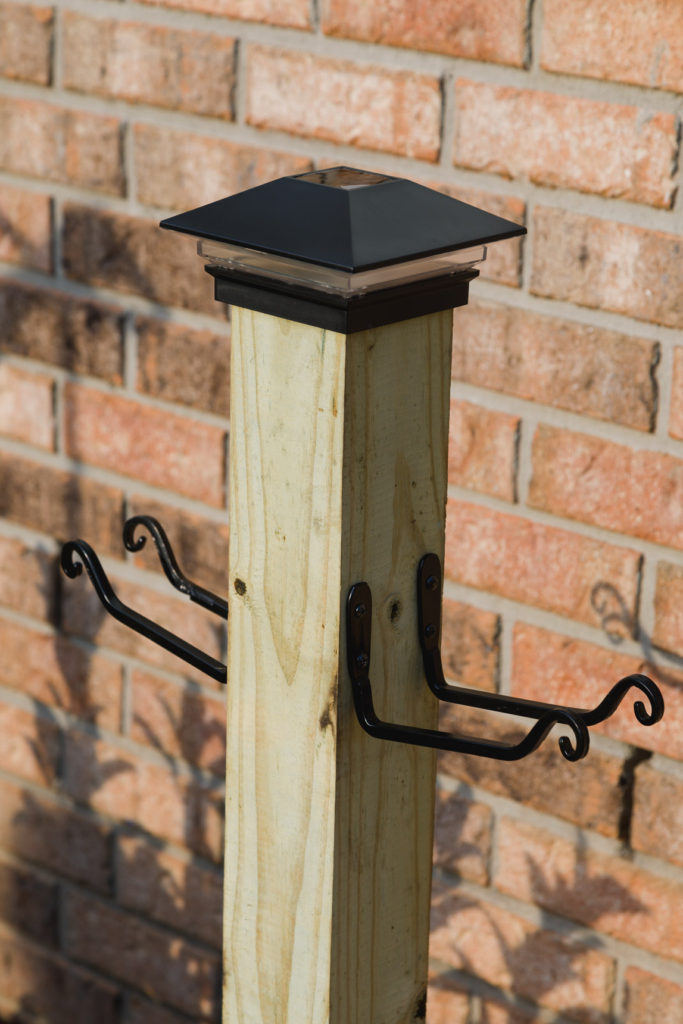 Garden hose post with hooks