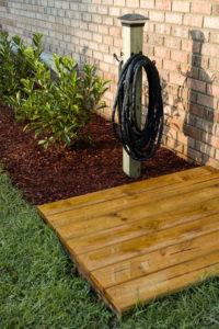 Finished deck and garden hose hook post