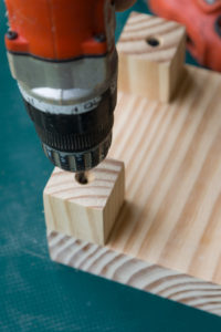 Drilling through the leg to the riser top