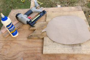 Paper pumpkin pattern on wood