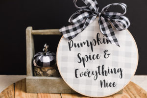 Easy sew fabric pumpkin placed on the wood slice