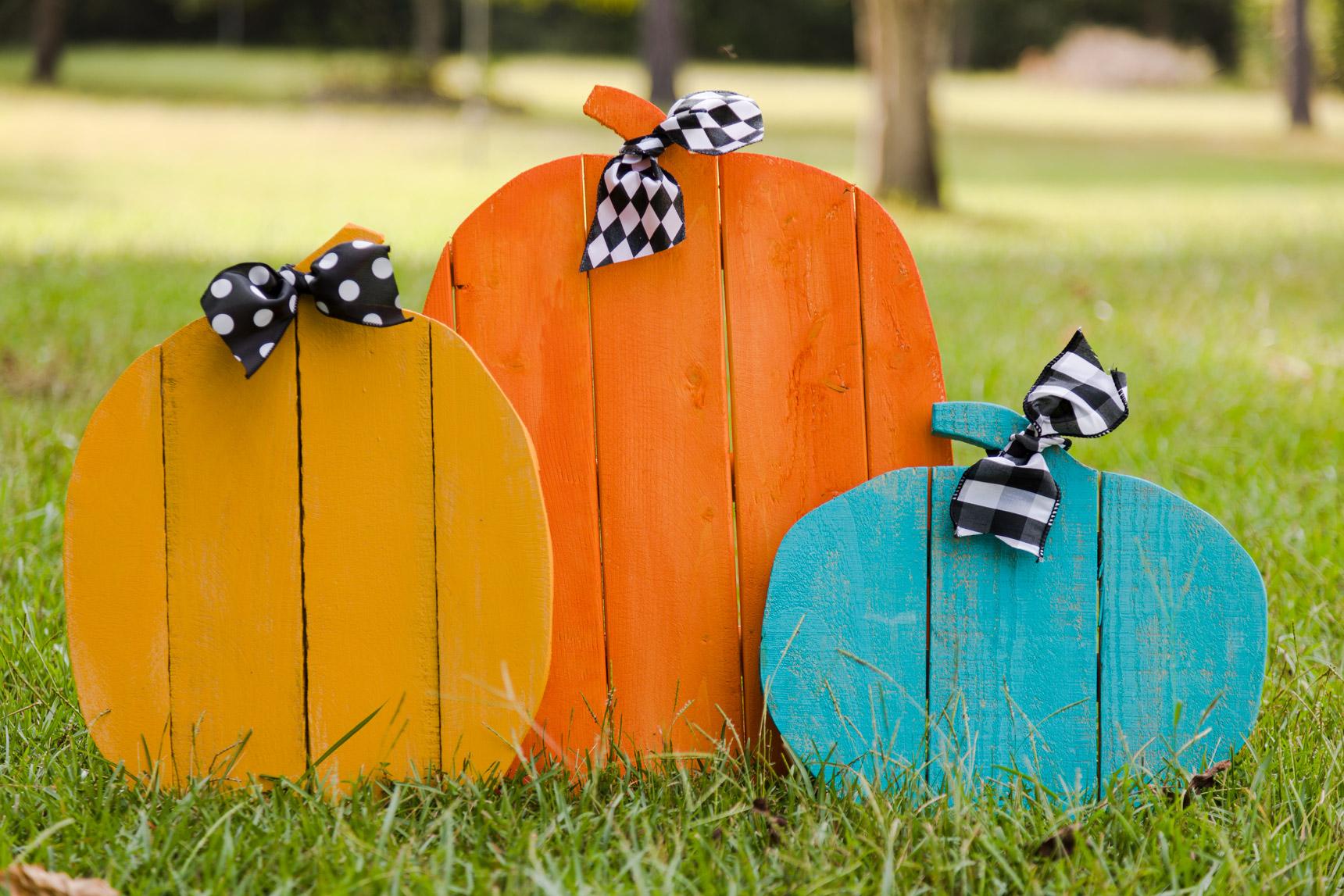 Orange, yellow and teal pustic pallet pumpkins