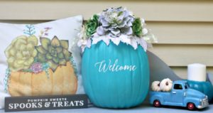 Teal-Pumpkin-Project-succulent-pumpkin-on-porch-with-pillow-and-small-truck