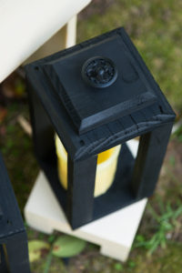 Lanterns topped with Vintage cabinet knobs spray painted black