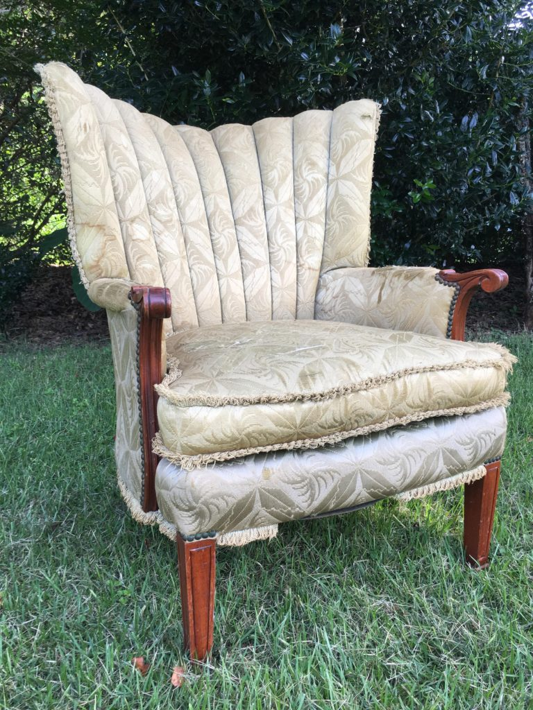 Worn, water stained, and tattered loop fringe on chair upholstery