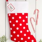 Handmade Christmas stocking red with white polka dots and a white cuff and a name tag