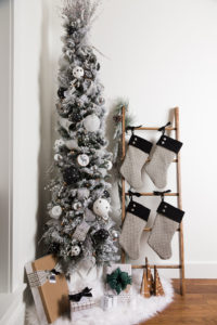 Christmas tree, ladder with Christmas stockings, tree stand
