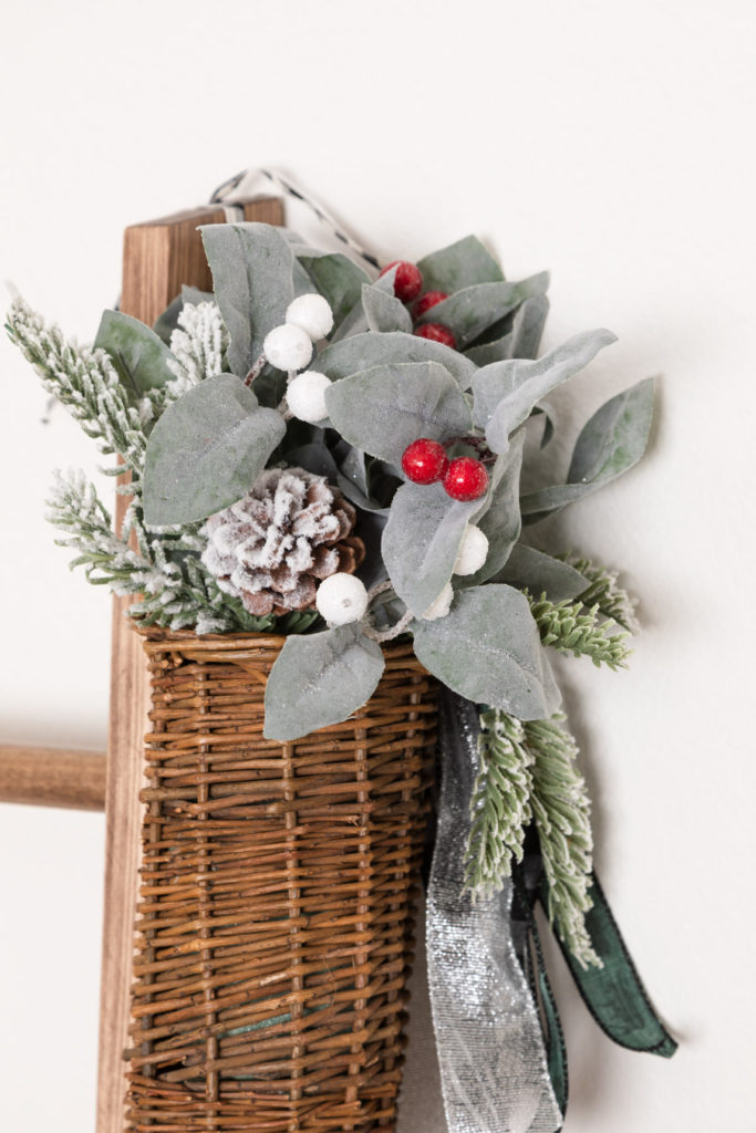 Willow basket with Christmas floral and ribbons