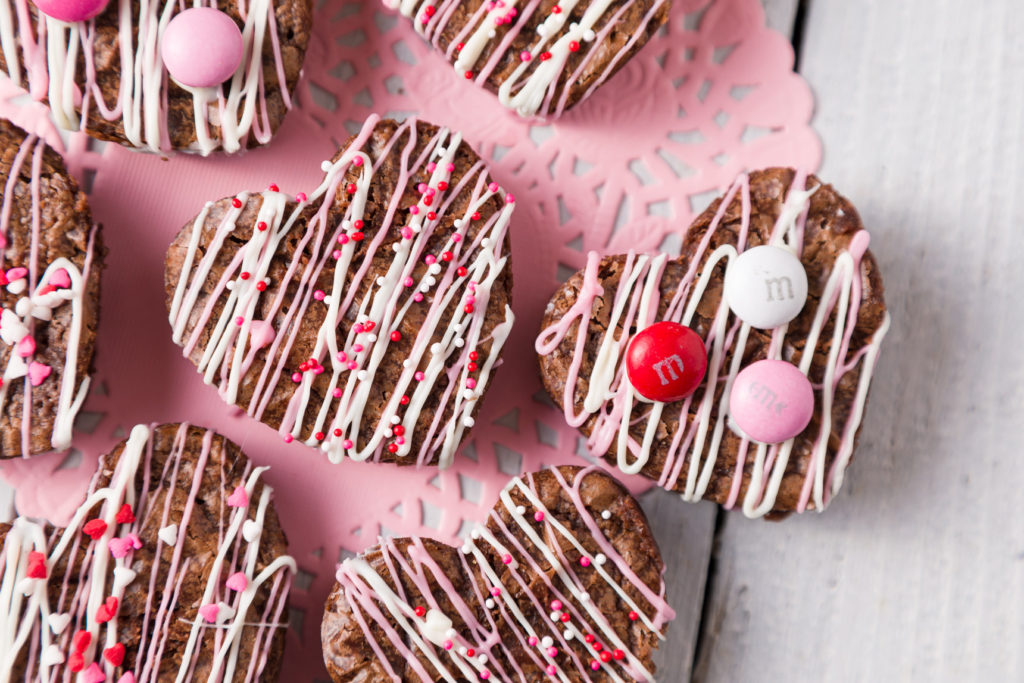 Heart-shaped brownies with candy garnish