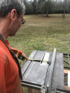 Floating shelf setting the table saw fence