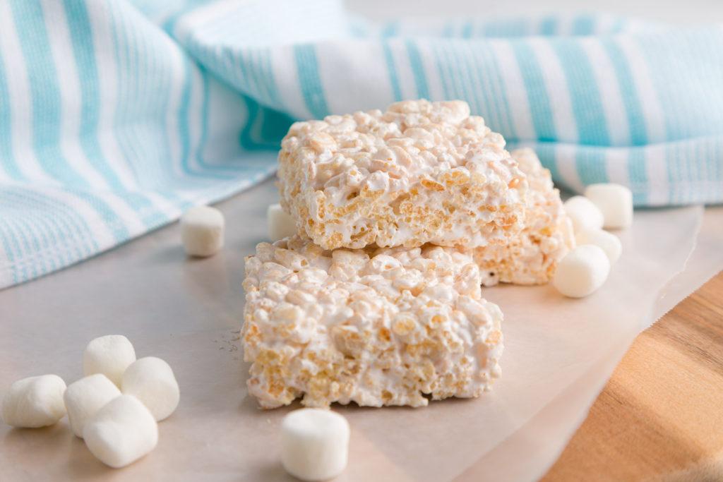 Rice Krispie Treats with marshmallows on wax paper