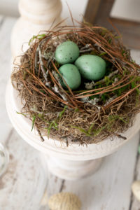 DIY Spring Decor bird nest on pedestal