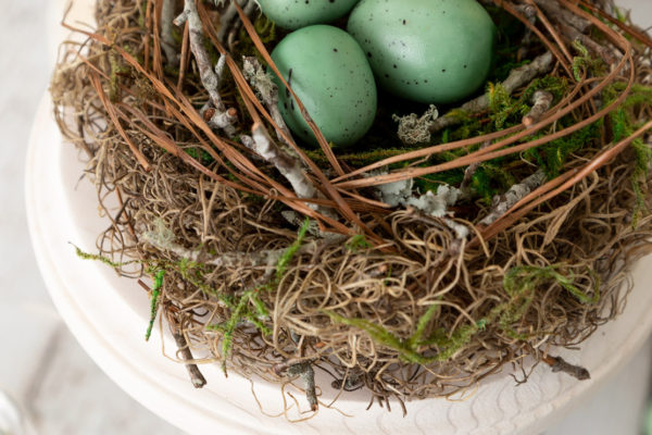 DIY Spring Decor bird nest on pedestal