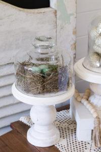 Handmade bird nest on cupcake stand
