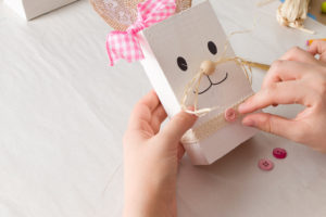 Adding a pink button to the reclaimed wood Easter Bunny