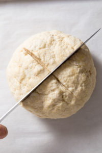 Cut an x on the top of dough