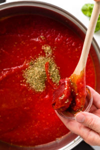 Add tomato paste to crushed tomatoes tomato sauce