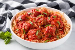 Tomato sauce served over meatballs and spaghetti