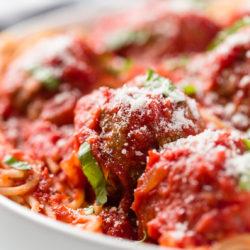 Marinara sauce on meatballs and spaghetti