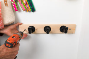 Use a level to Install the industrial pipe coat hooks