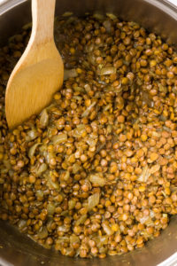 Adding lentils to sautéd onions